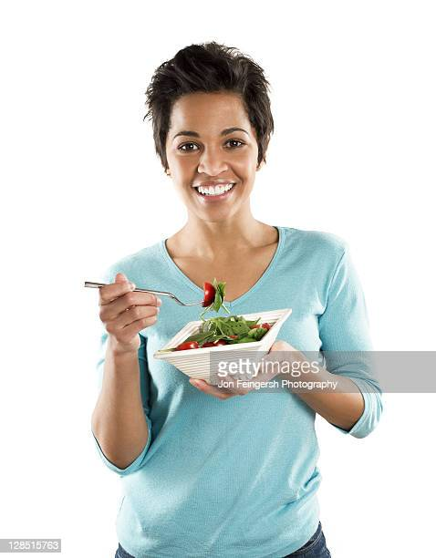 Portrait of a mid adult woman eating fruit salad