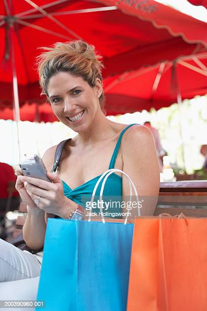 Portrait of a mid adult woman holding a mobile phone