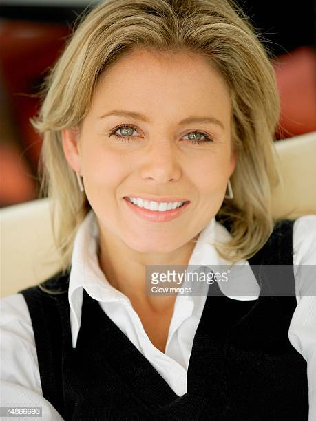 portrait of a mid adult woman smiling - sweater vest stock photos and pictures
