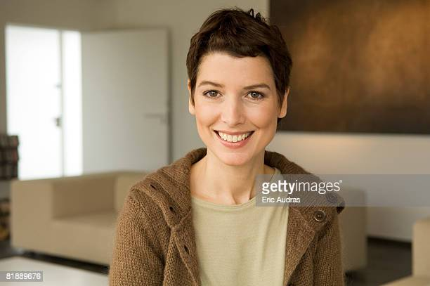 portrait of a mid adult woman smiling - mid adult woman sweater stock pictures, royalty-free photos & images