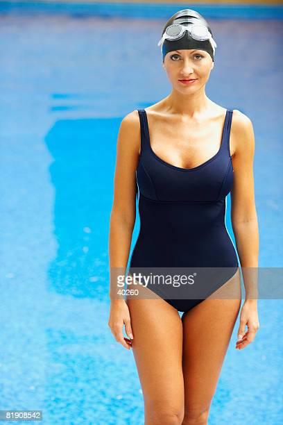 Portrait of a mid adult woman standing near a swimming pool