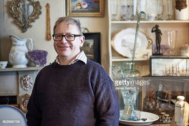 a portrait of a middle aged antique dealer - eccentric stock pictures, royalty-free photos & images
