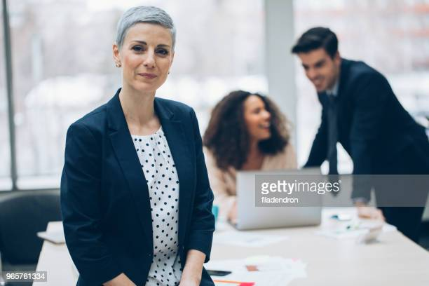 portrait of a middle aged businesswoman - mid adult women stock pictures, royalty-free photos & images