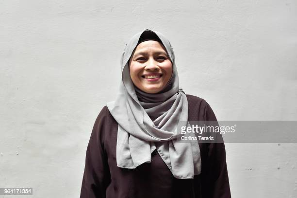portrait of a middle aged malay woman - malaysian culture stock pictures, royalty-free photos & images