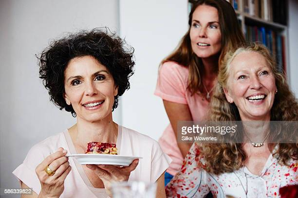 portrait of a middle-aged woman eating raspberry cake