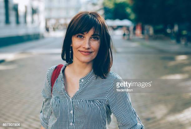 portrait of a middle-aged woman - brown hair stock pictures, royalty-free photos & images