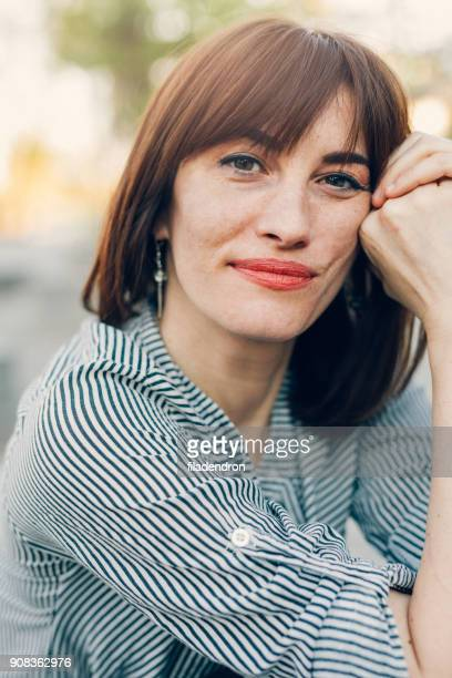 portrait of a middle-aged woman - bad bangs stock pictures, royalty-free photos & images