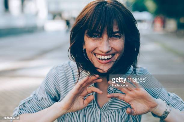 portrait of a middle-aged woman - waving gesture stock photos and pictures