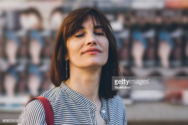 portrait of a middle-aged woman - eyes closed stock photos and pictures
