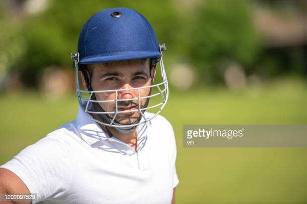 portrait of a middle-eastern cricket player wearing a helmet - cricket player stock pictures, royalty-free photos & images
