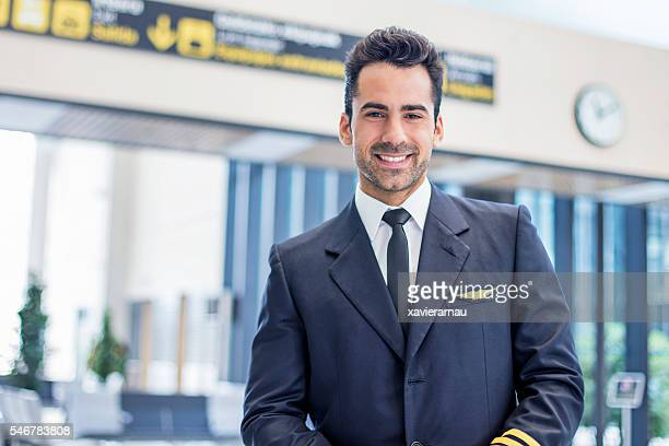 Portrait of a mide adult pilot waiting in the airport