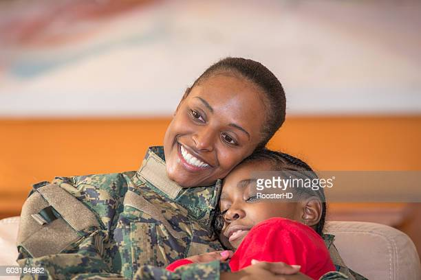 Portrait of a Military Mother Embracing her Daughter