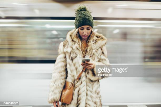 portrait of a millenial girl staring at her phone - central europe stock photos and pictures