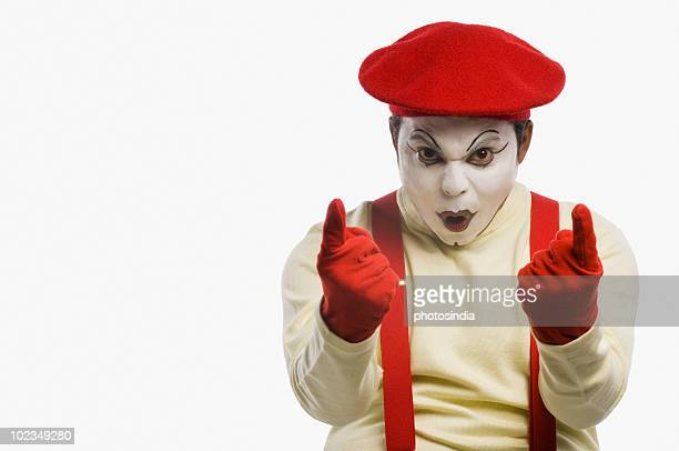 Portrait of a mime gesturing
