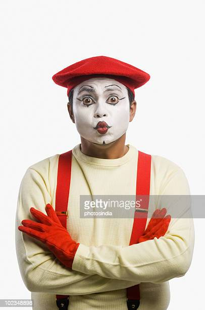 Portrait of a mime puckering