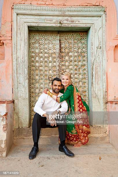 Portrait Of A Mixed Race Couple In A Doorway With Her Wearing A Sari