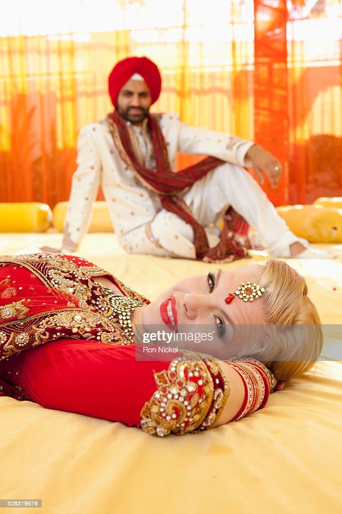 f4b8513c21c88 Portrait of a mixed race couple on their wedding day in traditional indian  garments for a