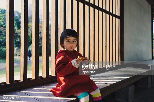 Portrait of a mixed race toddler girl looking at camera