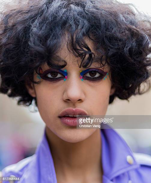 Portrait of a model with colorful eye make up seen outside Fendi during Milan Fashion Week Fall/Winter 2016/17 on February 25 in Milan Italy