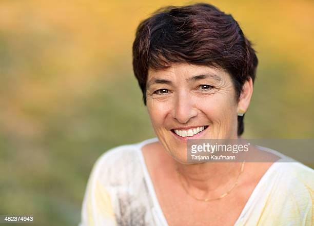Portrait of a modern 52 year old woman smiling