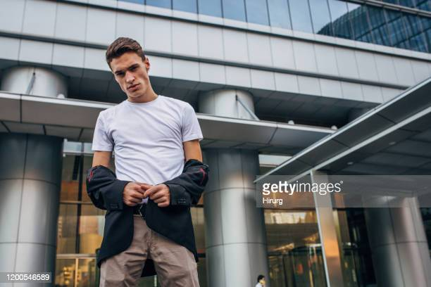 portrait of a modern young man - gray blazer stock pictures, royalty-free photos & images
