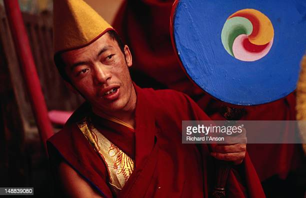 portrait of a monk preparing to play drum at the mani rimdu festival at chiwang gompa (monastery). - mani rimdu festival stock pictures, royalty-free photos & images