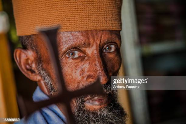 Portrait of a monk with the Orthodox cross in the monasteries on the islands of Lake Tana, Gondar, Ethiopia