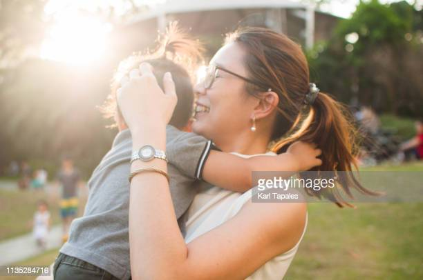 a portrait of a mother and child outdoor - filipino family stock pictures, royalty-free photos & images