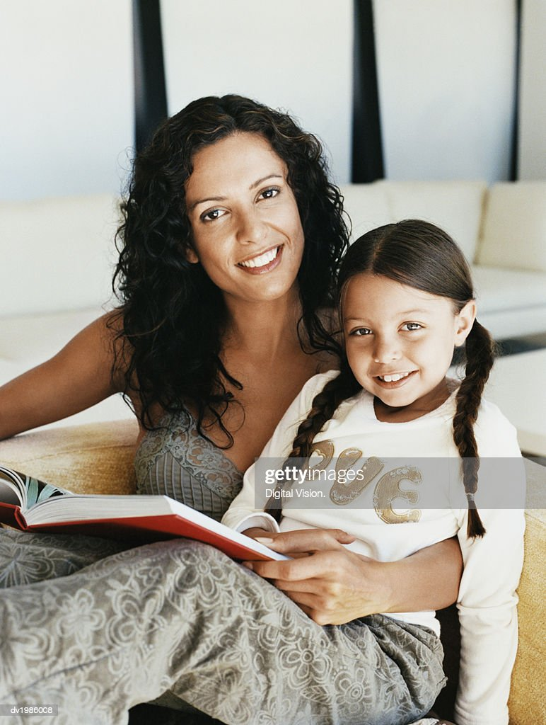 Portrait of a Mother and Daughter Reading Together : Stock Photo