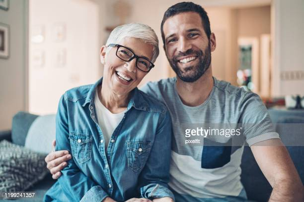 portrait of a mother and her adult son - son stock pictures, royalty-free photos & images
