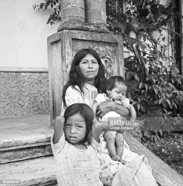 Portrait of a mother and her children at the city of Tena, Ecuador 1960s.