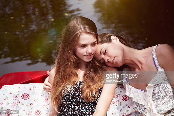 portrait of a mother and her teenage daughter relaxing in a red boat