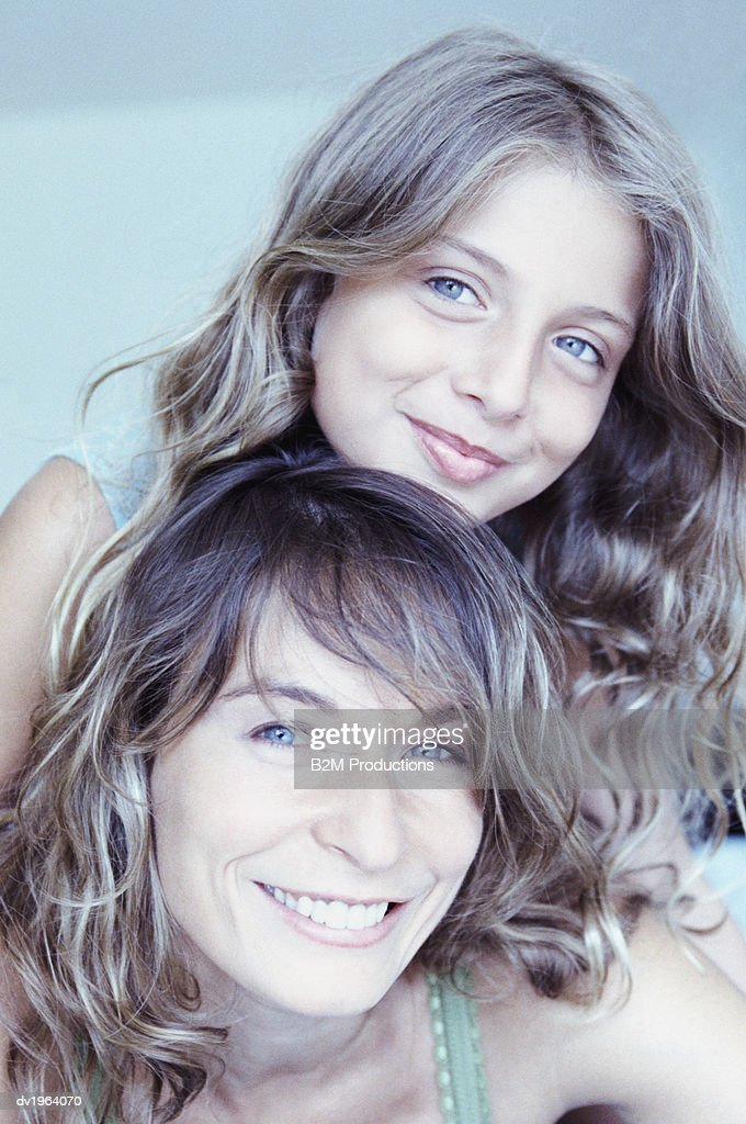 Portrait of a Mother With her Daughter : Stock Photo