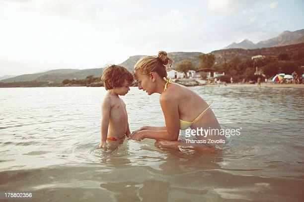 Portrait of a mother with her kid on the beach