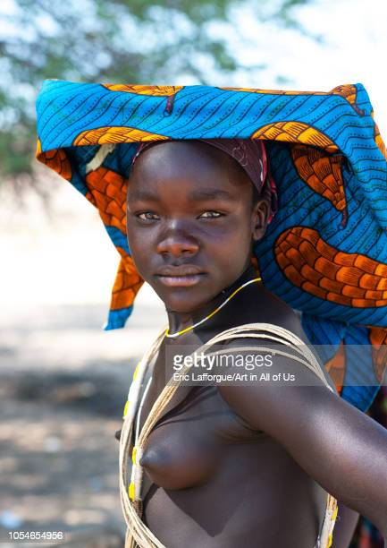 Portrait of a Mucubal tribe young woman wearing a colorful headwear Namibe Province Virei Angola on November 28 2010 in Virei Angola