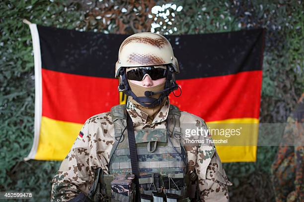 Portrait of a mummed soldier of the German Federal Armed Forces standing in front of a German flag on July 14 in Laupheim Germany
