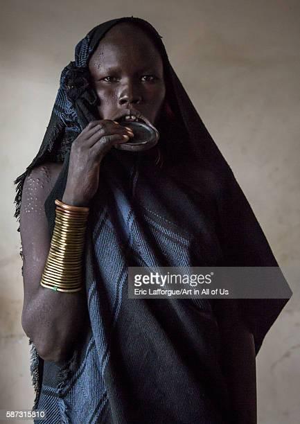 Portrait of a mursi tribe woman with lip plate omo valley hana mursi Ethiopia on March 19 2016 in Hana Mursi Ethiopia