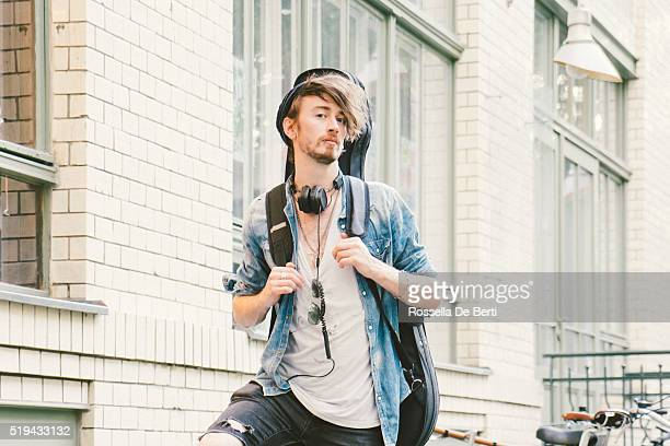 portrait of a musician in urban landscape - guitar case stock pictures, royalty-free photos & images