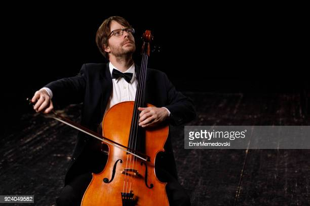 portrait of a musician playing cello - string instrument stock photos and pictures