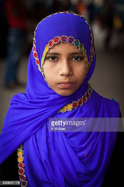 Portrait of a Muslim girl when she is waiting to travel to her village by train in Dhaka Bangladesh July 15 2015