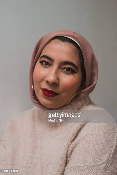 Portrait of A Muslim Woman in Pink Hijab and Red Lipstick