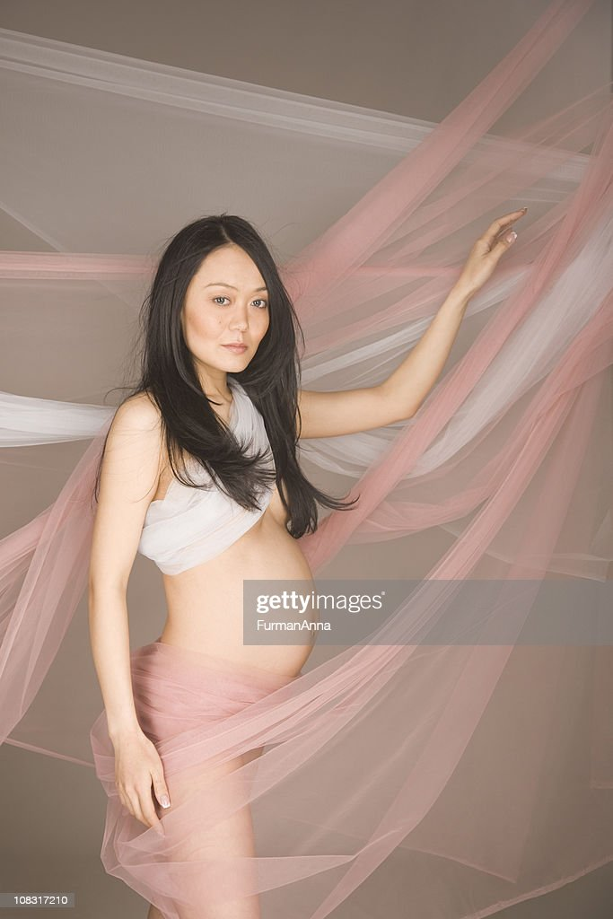 Portrait of  a naked pregnant asian  woman : Stock Photo