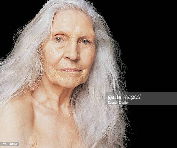 Portrait of a Naked Senior Woman With Long, White Hair