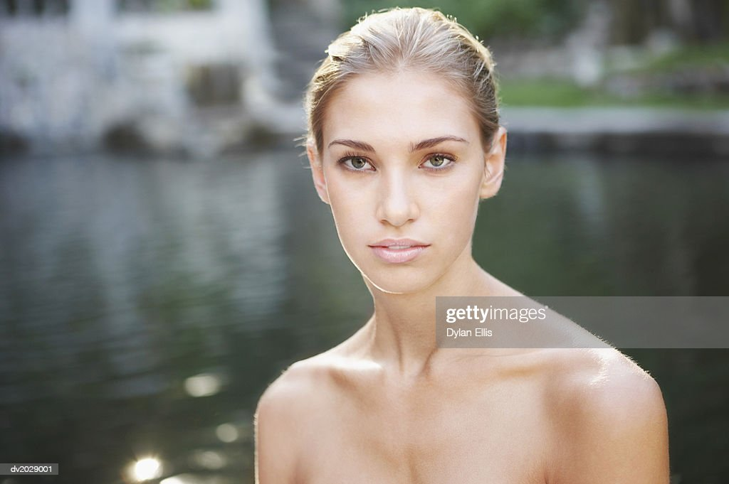 Portrait of a Naked Woman by a Lake : Stock Photo