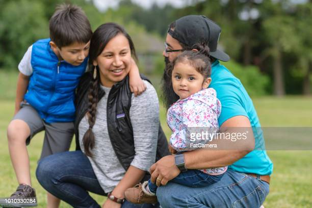 Portrait of a Native American family outdoors