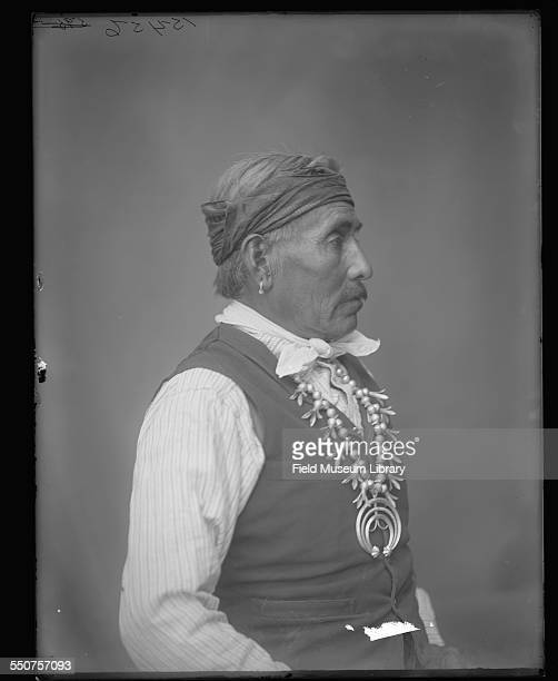Portrait of a Native American Navajo man Vincente Be Gay wearing a silver squash blossom necklace and a handkerchief around his forehead at the...