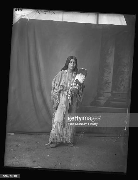 Portrait of a Native American Wichita woman holding a feather fan at the Louisiana Purchase Exposition St Louis Missouri June 6 1904