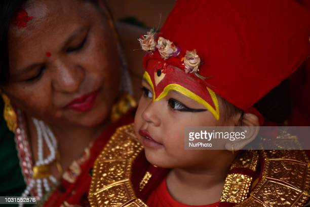 A Portrait of a Nepalese young girl impersonate as a Kumari or living Goddess participate in the ritual during celebration of Kumari puja at...