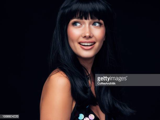 portrait of a nice looking woman - black hair stock pictures, royalty-free photos & images