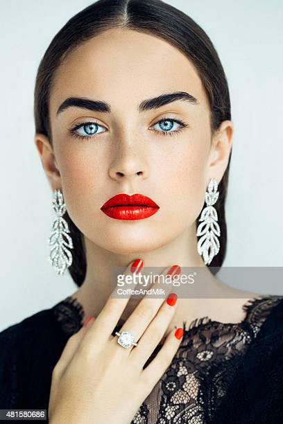 portrait of a nice looking woman - earring stock pictures, royalty-free photos & images